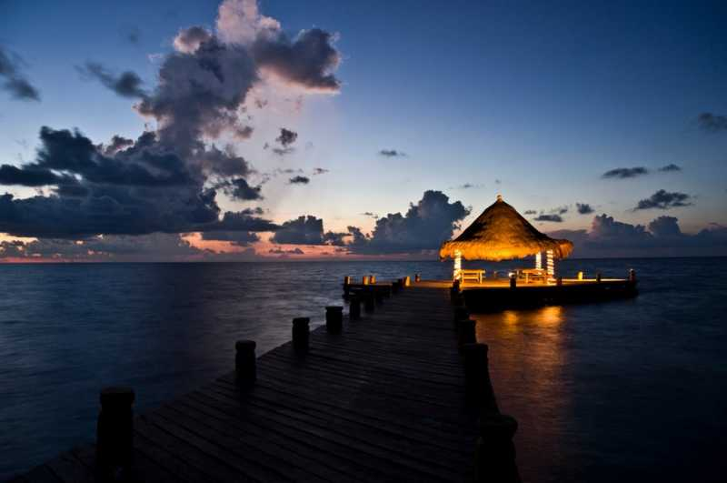 Nighttime view of the Private Pier at Ceiba del Mar, Puerto Morales MX